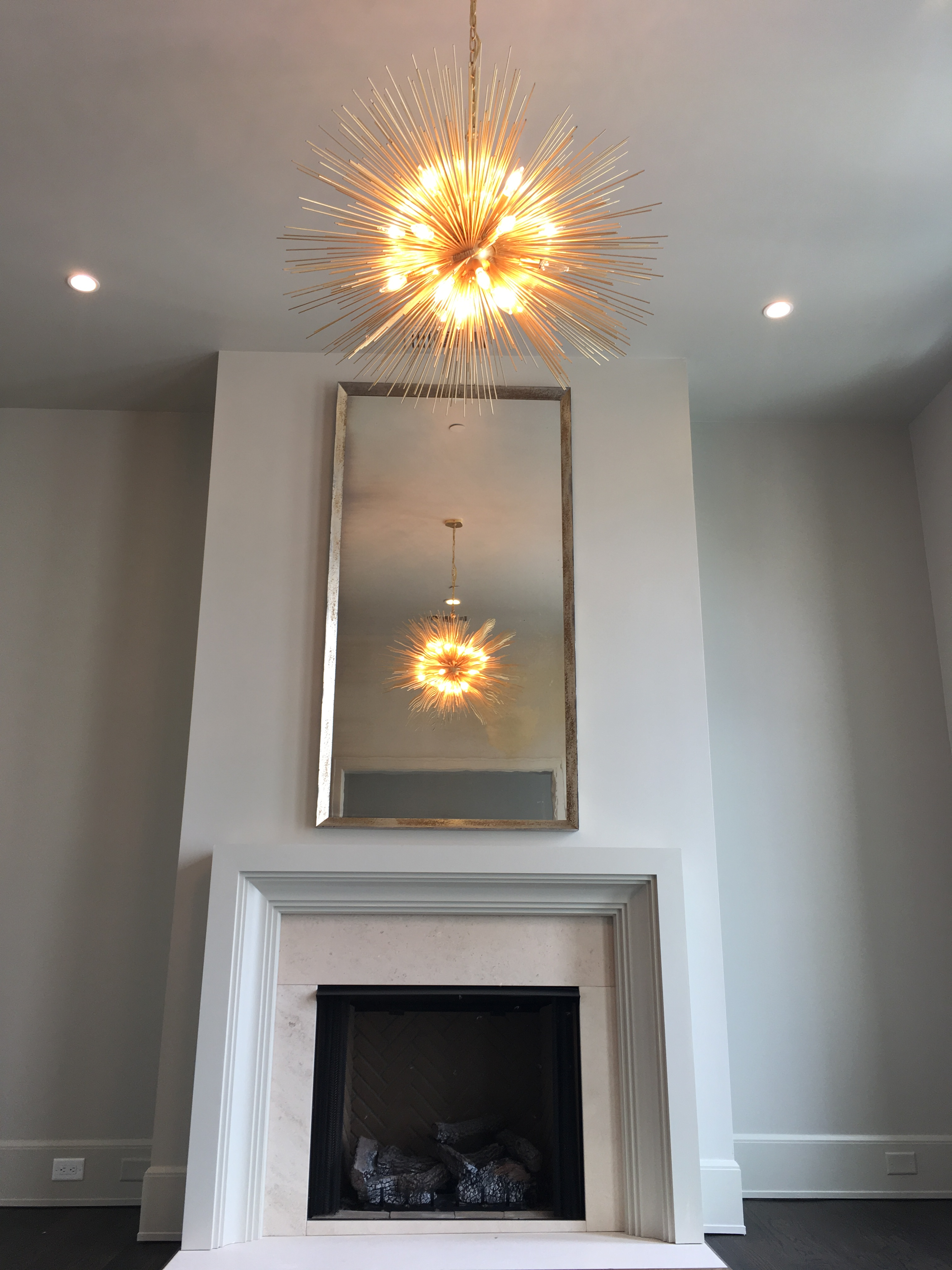 dainty houzz above design essential pretty soothing also round mirrors by dan with mirror fireplacepertaining zn fireplace hanging january tips in a gregory on to